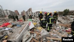 Rescue workers work at the site of a blast in Ningbo, Zhejiang province, China November 26, 2017.