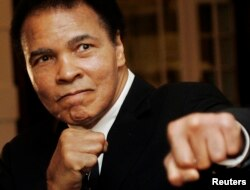 FILE - U.S. boxing great Muhammad Ali poses during the Crystal Award ceremony at the World Economic Forum (WEF) in Davos, Switzerland, January 2006.