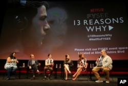 "FILE - Jenelle Riley, director Tom McCarthy, Dylan Minette, Katherine Langford, Kate Walsh and executive producer Brian Yorkey talk about Netflix's ""13 Reasons Why"" at an event at the Samuel Goldwyn Theater, Los Angeles, June 2, 2017."