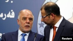 Haider al-Abadi, left, has been nominated as Iraq'a prime minister. He's shown with Salim al-Jabouri, speaker of the Iraqi Council of Representatives in Baghdad on July 15, 2014.