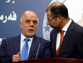 Haider al-Abadi, left, has been nominated as Iraq's prime minister. He's shown with Salim al-Jabouri, speaker of the Iraqi Council of Representatives in Baghdad, on July 15, 2014.