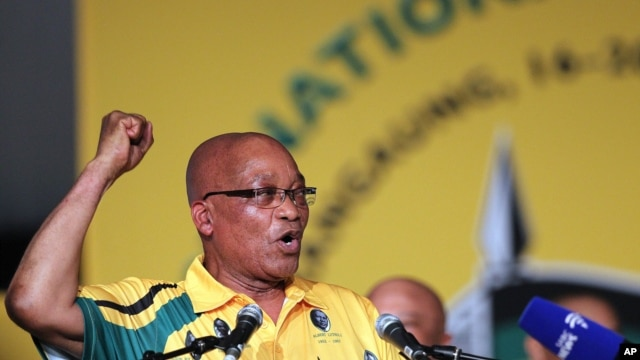 President Jacob Zuma sings before addressing delegates during the opening of their elective conference of the ruling African National Congress (ANC) at the University of the Free State in Bloemfontein, South Africa, December 16, 2012.