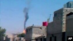 지난달 27일 시리아 다마스쿠스에서 촬영된 정부군 헬기 추락 장면. (자료 사진)