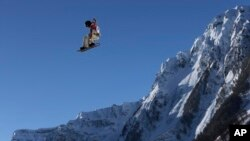 Shaun White of the United States takes a jump during a Snowboard Slopestyle training session at the Rosa Khutor Extreme Park, prior to the 2014 Winter Olympics, Feb. 4, 2014, in Krasnaya Polyana, Russia.