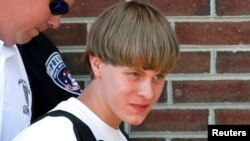 FILE - Police lead suspected shooter Dylann Roof into the courthouse in Shelby, North Carolina, June 18, 2015.