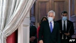Photo released by the Chilean Presidency of Chilean President Sebastian Pinera arriving at La Moneda presidential palace, in Santiago, on October 12, 2021.