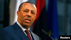 FILE - Libyan Prime Minister Abdullah al-Thinni takes part in a news conference in Valletta, Malta, Oct. 21, 2014.