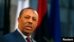 FILE - Libya's Prime Minister Abdullah al-Thinni takes part in a news conference in Valletta, Malta, Oct. 21, 2014