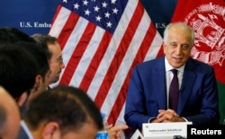 FILE - U.S. special envoy for peace in Afghanistan, Zalmay Khalilzad, talks with local reporters at the U.S. embassy in Kabul, Afghanistan, Nov. 18, 2018. (U.S Embassy handout via Reuters)