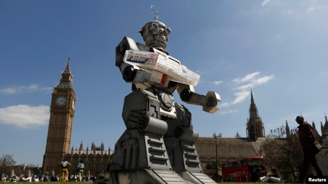 A robot is pictured in front of the Houses of Parliament and Westminster Abbey as part of the Campaign to Stop Killer Robots in London, April 23, 2013.
