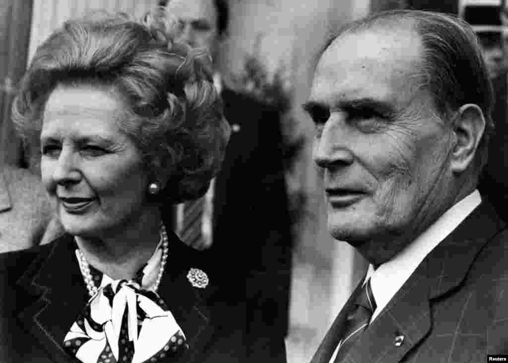 Then British Prime Minister Margaret Thatcher and French President Francois Mitterrand posed for the media after a meeting about nuclear arms control at the Chateau de Benouville in Normandy, western France, March 23, 1987.