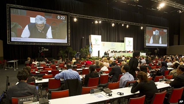 Delegates continue debating into the night during the United Nations Climate Change Conference (COP17) in Durban, South Africa, December 9, 2011.