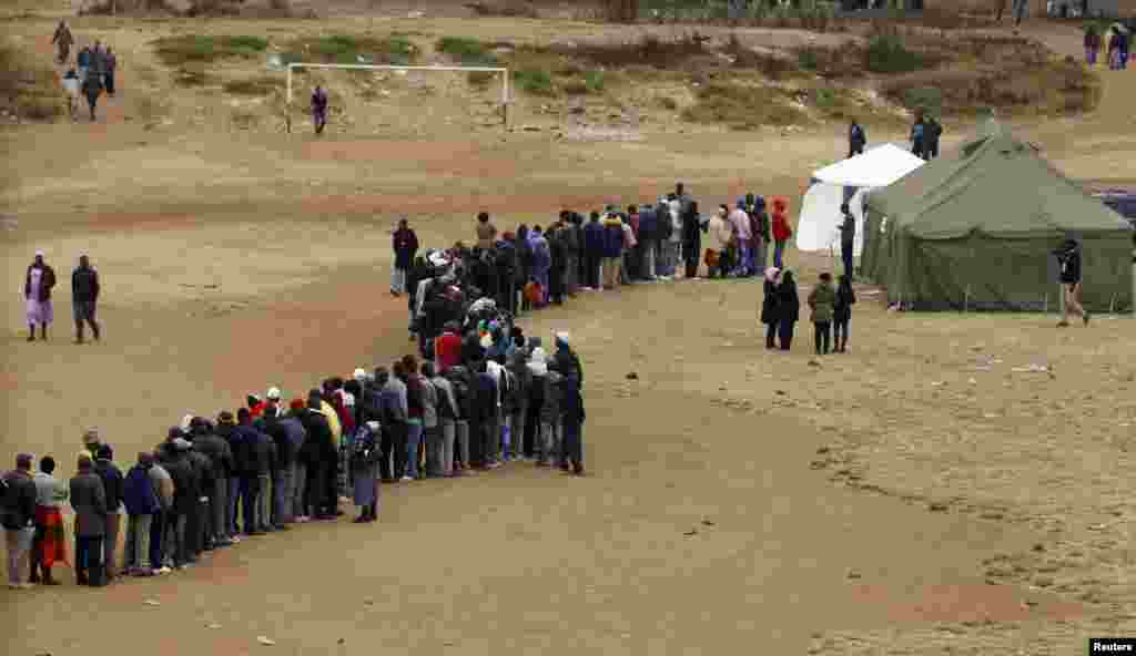 Zimbabweans wait in line to cast their votes in Mbare township outside Harare.