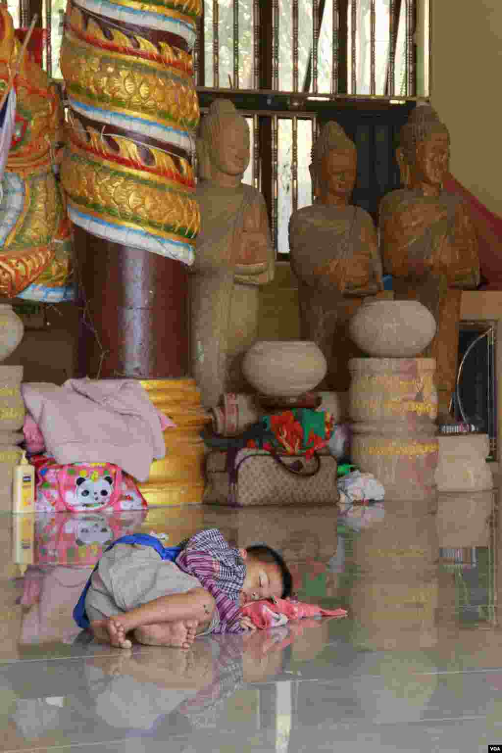 A boy is taking a nap during an afternoon in Samakki Raingsey temple in Phnom Penh, Cambodia, February 5, 2015.