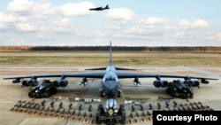 United States B-52 bomber, as shown in the above photo, is training over South Korea. (Courtesy - U.S. Air Force)