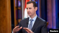 Syria's President Bashar al-Assad speaks during an interview with Fox News channel in Damascus, Sept. 19, 2013. ( SANA Handout photo)