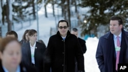 Steven Mnuchin, United States Secretary of the Treasury, walks through the snow during the annual meeting of the World Economic Forum in Davos, Switzerland, Jan. 24, 2018.