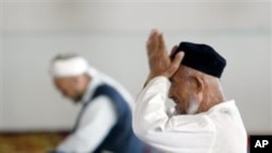 Muslims pray at Mosque in Uzbekistan.