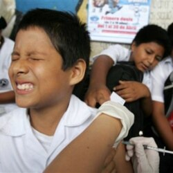 A boy in Lima, Peru, reacts to a hepatitis B vaccine