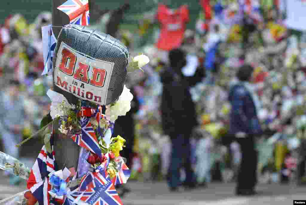 Messages are seen with flowers at the scene of the killing of British soldier Lee Rigby in Woolwich, southeast London. Rigby was killed on a busy London street near an army barracks last week.