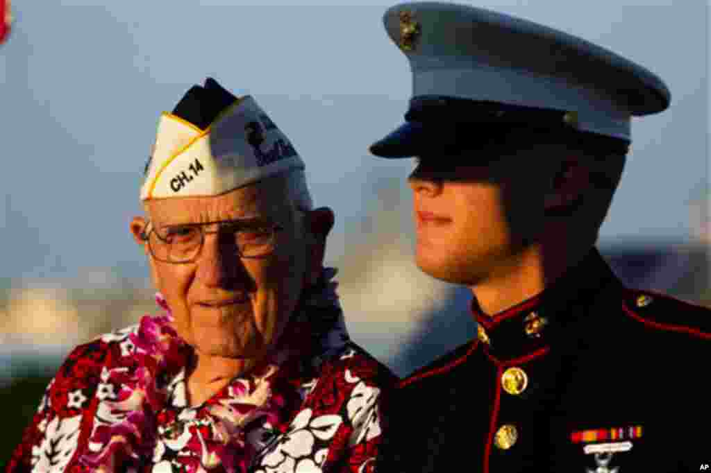 Pearl Harbor survivor John Hughes, left, and Lance Cpl. Zackary Morphew attend the 69th anniversary ceremony marking the attack on Pearl Harbor, Tuesday, Dec. 7 in Pearl Harbor, Hawaii. (Marco Garcia/AP)
