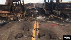 """FILE - """"No DAPL,"""" or Dakota Access pipeline, is spray painted across the site of a protest flare up in North Dakota. (J. Patinkin/VOA)"""