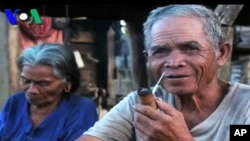 An elderly couple, one of the minority villagers, living in Ratanakirri, are also caught up in a land dispute with the sister of Cambodia's Finance Minister, Keat Chhon, file photo.