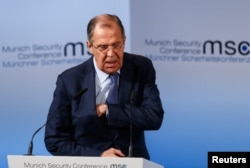 Russian Foreign Minister Sergei Lavrov walks before delivering his speech during the Munich Security Conference in Munich, Germany, Feb. 18, 2017.