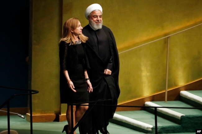 Iran's President Hassan Rouhani is escorted to address the Nelson Mandela Peace Summit in the United Nations General Assembly, at U.N. headquarters, Monday, Sept. 24, 2018.