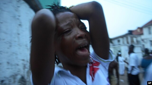 A supporter of the opposition Sierra Leone People's Party party cries outside a party office after candidate Julius Maada Bio lost last week's presidential election, Freetown, Sierra Leone, Nov. 23, 2012.