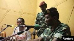 FILE - Major General Godefroid Niyombare, one of the four people sanctioned, addresses the nation inside the Radio Publique Africaine (RPA) broadcasting studios in Burundi's capital Bujumbura, May 13, 2015.