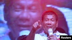 FILE - Philippine presidential candidate and Davao city mayor Rodrigo 'Digong' Duterte speaks during campaign rally in Manila May 1, 2016.