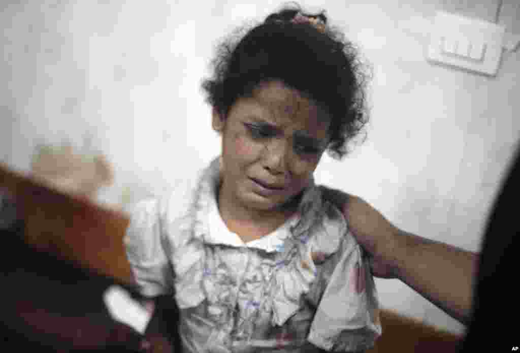 A Palestinian girl cries while receiving treatment for her injuries caused by an Israeli strike at a U.N. school in Jebaliya refugee camp, at the Kamal Adwan hospital in Beit Lahiya, northern Gaza Strip, July 30, 2014.