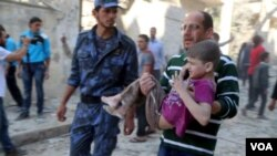 A child injured in a bombing in Syria is rushed to medical help.