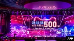 A screen shows the gross merchandise volume, a measure of sales, after 12 minutes 49 seconds of Singles Day sales, as it reaches about 7,147,554,107 USD in Hangzhou in China's eastern Zhejiang province early on November 11, 2019.