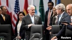 U.S. Secretary of State Rex Tillerson (C) and others wait for an opening session meeting of G-20 foreign ministers in Bonn, Feb. 16, 2017.