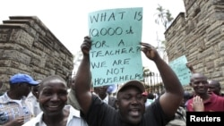 Teachers demonstrate outside Kenya's Parliament Buildings in the capital Nairobi September 7, 2011. Many Kenyan state schools remained closed on Tuesday after thousands of teachers went on strike to try to force the government to increase their numbers. T