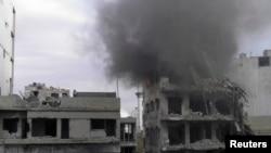 被叙利亚政府军炸毁的霍姆斯部分建筑 2014年1月9日