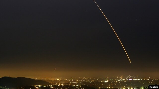 An unarmed Minuteman III intercontinental ballistic missile streaks through the sky of Vandenberg in California Aug. 25, 2005.