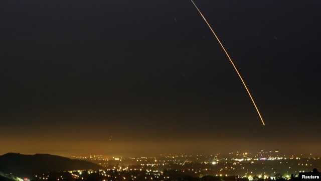 FILE - An unarmed Minuteman intercontinental ballistic missile streaks through the sky during a test launch, over Vandenberg Air Force Base in California Aug. 25, 2005.