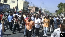 Haitians march in the streets of Port-au-Prince, to protest against the government, February 7, 2011