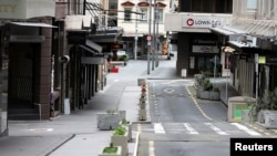 FILE - The normally bustling High Street in Auckland's CBD is largely deserted during a lockdown to curb the spread of a COVID-19 outbreak, in Auckland, New Zealand, Aug. 26, 2021.