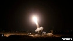 "FILE - An interceptor rocket is launched from an ""Iron Dome"" defense system in the southern Israeli city of Ashdod, July 11, 2014. The MOU signed in Washington Wednesday locks in an additional $500 million annually for Israeli missile defense."