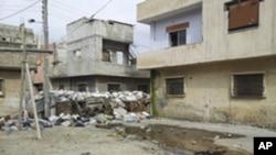 图为叙利亚霍姆斯地区被战火毁坏的房屋