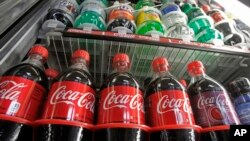 FILE - Sugar-sweetened drinks in a store's refrigerator, Feb. 20, 2013