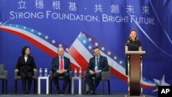 US Assistant Secretary of State for Education and Culture Affairs Marie Royce, right, delivers a speech during the dedication ceremony of the American Institute in Taiwan (AIT) new office complex, the de facto embassy, in Taipei, Taiwan, June 12, 2018.