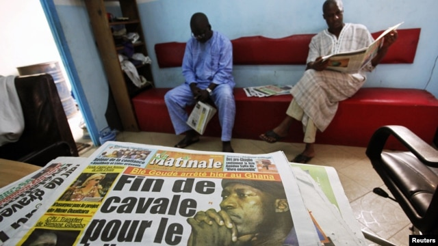 The front page of a newspaper featuring the arrest of Ivorian political leader Charles Ble Goude is seen in Abidjan, Ivory Coast, January, 18, 2013.