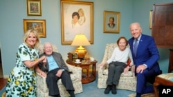 In this April 30, 2021, photo released by The White House, former President Jimmy Carter and former first lady Rosalynn Carter pose for a photo with President Joe Biden and first lady Jill Biden at the home of the Carter's in Plains, Georgia. (Adam Schultz, The White House via AP))