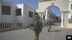 Israeli soldiers patrol in the village of Ghajar between northern Israel and Lebanon, 10 Nov 2010