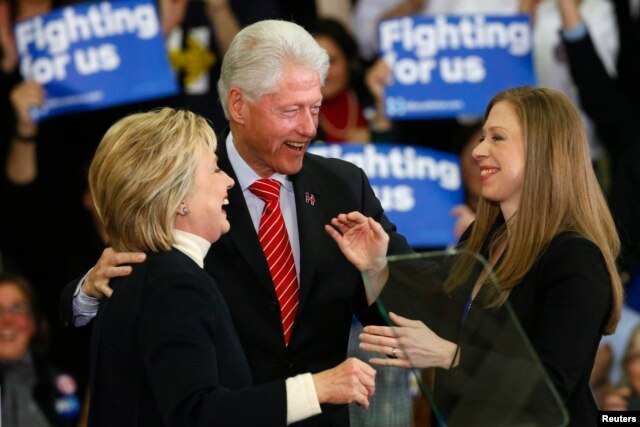 Democratic U.S. presidential candidate Hillary Clinton is accompanied by her daughter Chelsea Clinton (R) and her husband, former U.S. President Bill Clinton, as she speaks to supporters at her final 2016 New Hampshire presidential primary night rally.